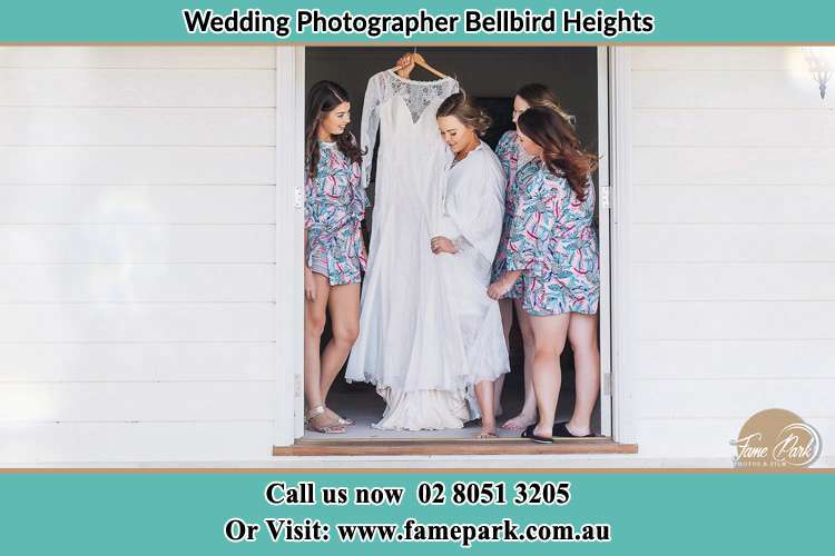 Photo of the Bride and her bridesmaids checking her wedding gown Bellbird Heights NSW 2325