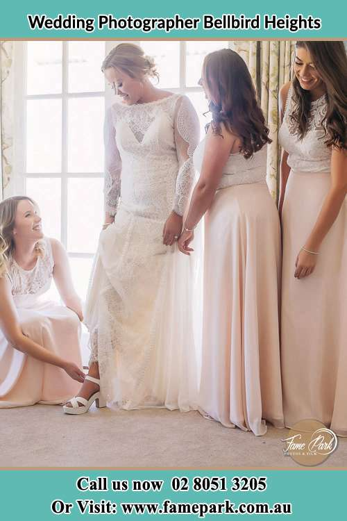 Photo of the Bride checking her shoes by her bridesmaids Bellbird Heights NSW 2325