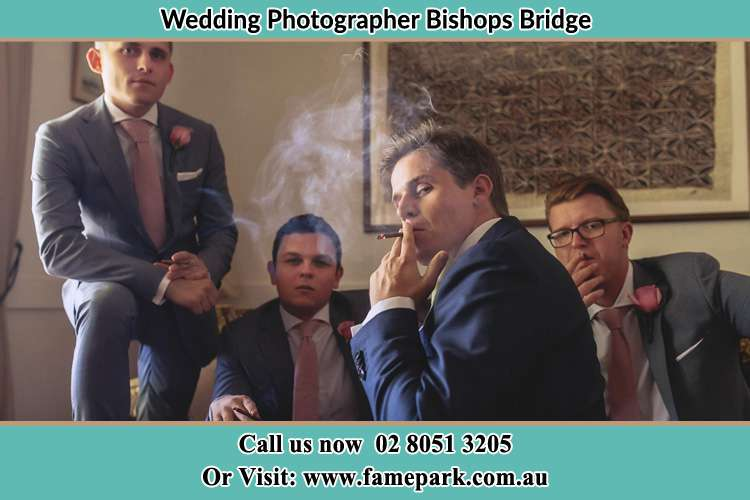 Photo of the Groom relaxing with the boys Bishops Bridge