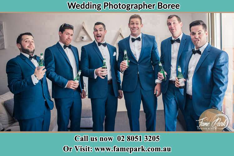 The groom and his groomsmen striking a wacky pose in front of the camera Boree NSW 2800