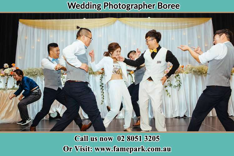 Photo of the Bride and the Groom having a group dance Boree