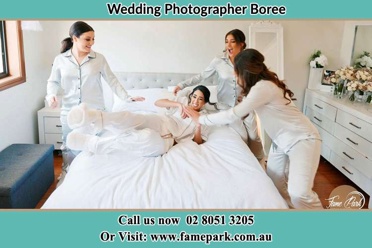 Photo of the Bride with her bridesmaids playing on bed Boree NSW 2800
