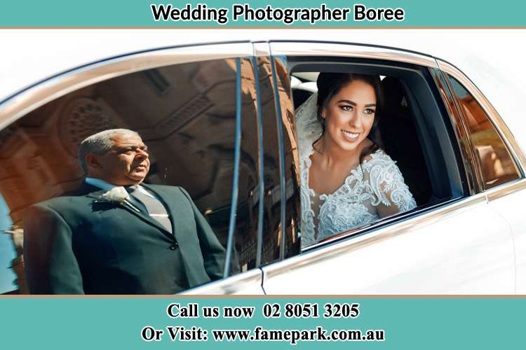Photo of bride in her bridal car Boree