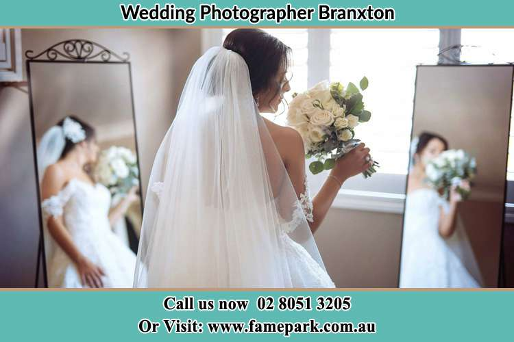 Photo of the Bride with flowers infront of the mirror Branxton