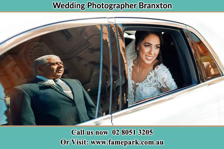 Photo of the Bride inside the bridal car with her father standing outside Boree NSW 2800