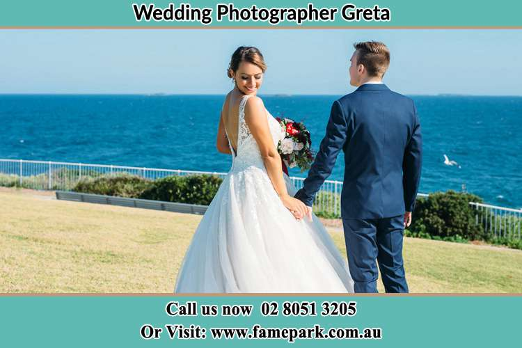 Photo of the Bride and the Groom holding hand at the yard Greta NSW 2334