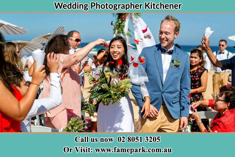 Photo of the Bride and the Groom showering flower petals by their visitors Kitchener NSW 2325