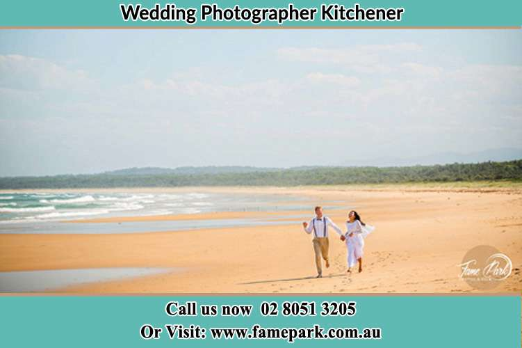 Photo of the Groom and the Bride walking at the sea shore Kitchener NSW 2325