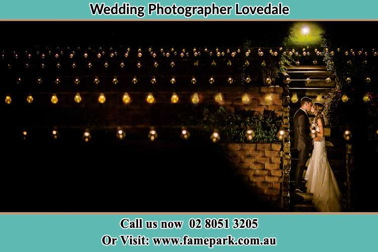 Cinematic photo of the Groom and the Bride kissing Lovedale NSW 2325