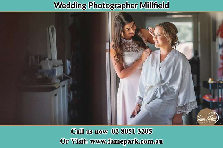 Photo of the Bride having make up Millfield NSW 2325