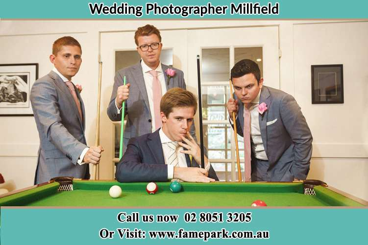 Groom playing pool with his secondary sponsors Millfield