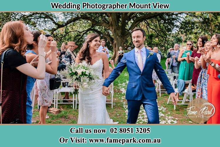 Photo of the Bride and the Groom showering bubbles by their visitors Mount View NSW 2325