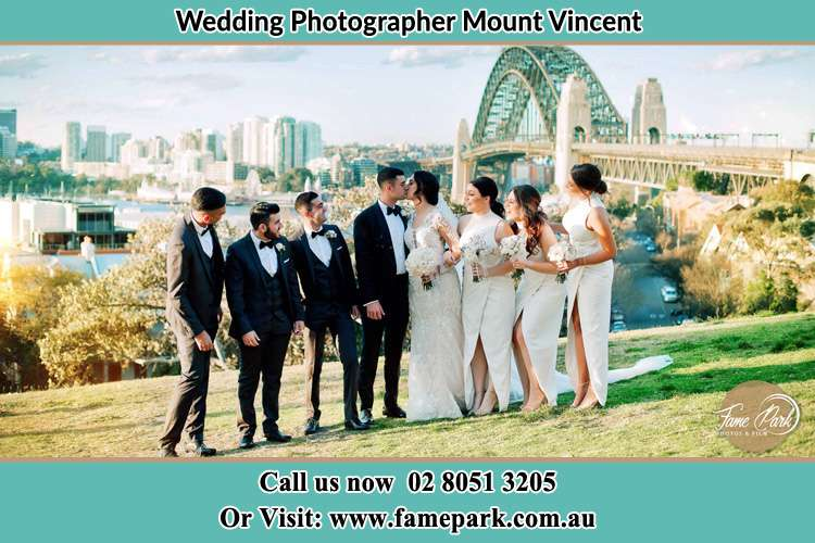 Bride and Groom With Their Secondary Sponsors Near the Bridge Mount Vincent