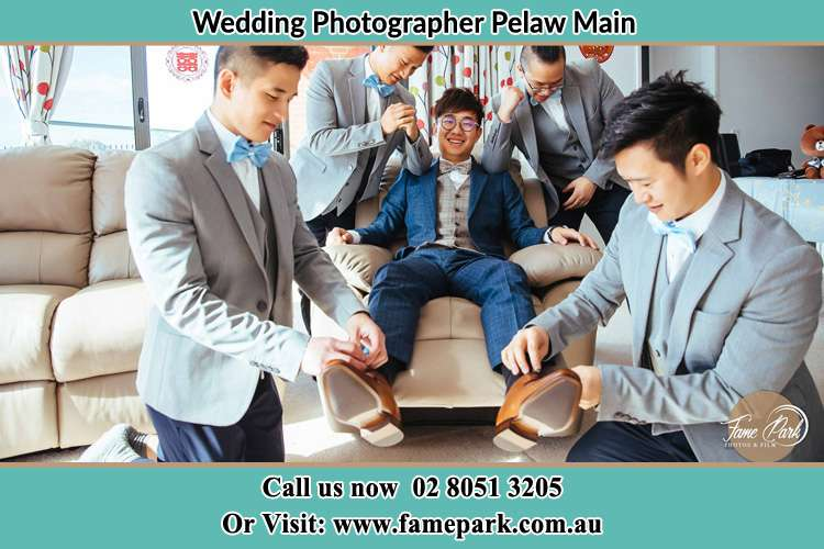 Photo of the Groom helping by his groomsmen to get ready Pelaw Main NSW 2327