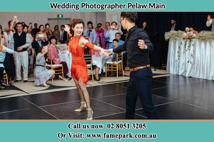 Photo of the Bride and the Groom dancing on the dance floor Pelaw Main NSW 2327