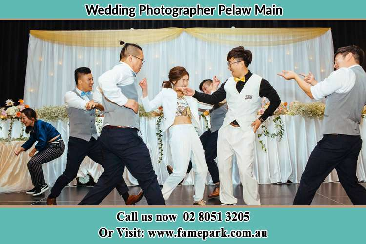 Photo of the Bride and the Groom dancing with the groomsmen Pelaw Main NSW 2327