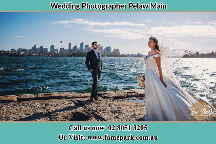 Photo of the Bride and the Groom at the sea front Pelaw Main NSW 2327