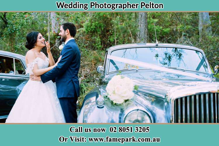 Photo of the Bride and the Groom beside the bridal car Pelton NSW 2325
