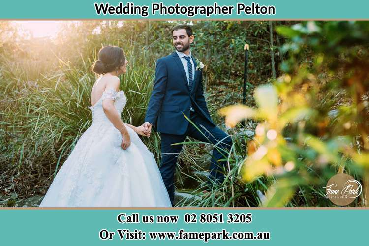 Photo of the Bride and the Groom going up hill Pelton NSW 2325