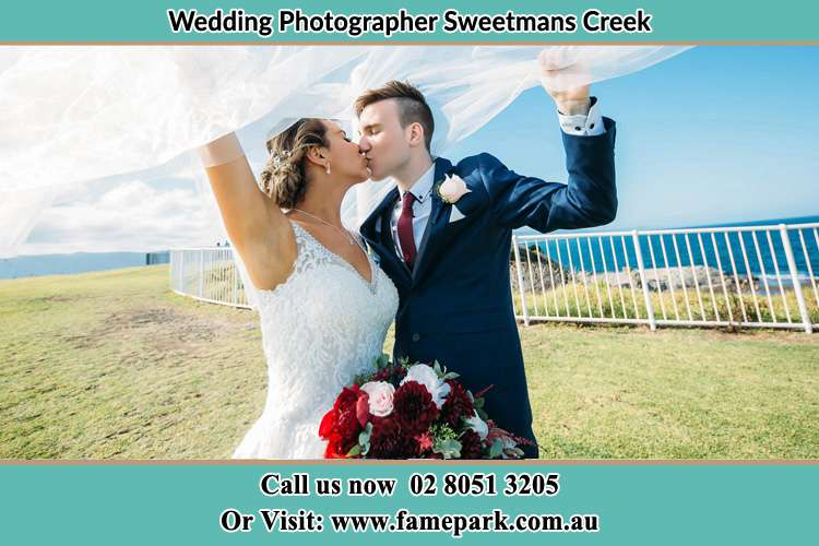 Photo of the Bride and the Groom kissing Sweetmans Creek NSW 2325