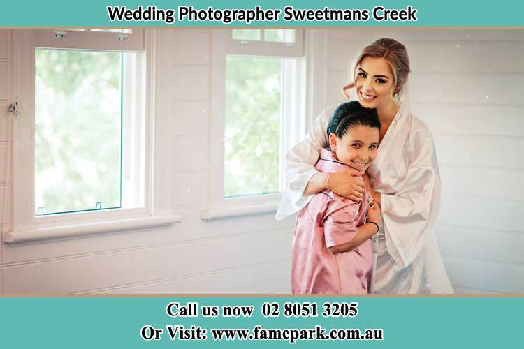 Photo of the Bride hugging her flower girl Sweetmans Creek NSW 2325
